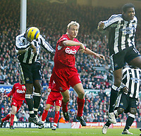 19/12/2004 - FA Barclays Premiership - Liverpool v Newcastle United - Anfield, Liverpool<br />Liverpool's Sami Hyypia scores the equalizing goal inbetween  Newcastle United's Patrick Kluivert (r) and Titus Bramble<br />Photo:Jed Leicester/Back Page Images