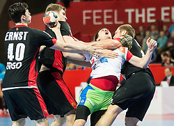 Sebastijan Skube of Slovenia between Finn Lemke of Germany and Steffen Weinhold of Germany during handball match between National teams of Germany and Slovenia on Day 6 in Preliminary Round of Men's EHF EURO 2016, on January 20, 2016 in Centennial Hall, Wroclaw, Poland. Photo by Vid Ponikvar / Sportida