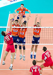Djuric Mitar Tzourits of Olympiacos vs Alen Sket, Matevz Kamnik and Andrej Flajs of ACH during volleyball match between ACH Volley (SLO) and Olympiacos (GRE) in 4th Round of 2011 CEV Champions League, on December 14, 2010 in Arena Stozice, Ljubljana, Slovenia.  (Photo By Vid Ponikvar / Sportida.com)
