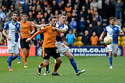 Blackburn Rovers midfielder Darragh Lenihan and Wolverhampton Wanderers striker Adam Le Fondre tussle for the ball 0-0 during the Sky Bet Championship match between Wolverhampton Wanderers and Blackburn Rovers at Molineux, Wolverhampton, England on 9 April 2016. Photo by Alan Franklin.