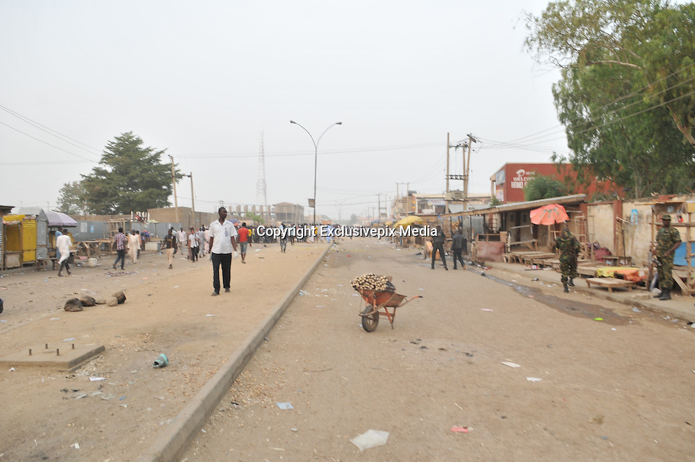 Nov. 18, 2015 - Kano, Nigeria - <br /> <br /> Female Suicide Bombers Strike Nigeria<br /> <br /> police keep people away from the scene of the bombing at the Farm centre phone market in Kano, Nigeria on 18th November 2015.<br /> &copy;Exclusivepix Media