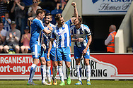 Joe Edwards of Colchester United (middle, #4) celebrates scoring his sides first goal to make the scoreline 1-1 during the Sky Bet League 1 match between Colchester United and Rochdale at the Weston Homes Community Stadium, Colchester<br /> Picture by Richard Blaxall/Focus Images Ltd +44 7853 364624<br /> 08/05/2016
