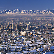 Salt Lake City, Utah, USA, winter snow covers cityscape and Front Range Mountains; site of 2001 Winter Olympic Games