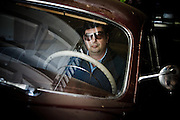"""Napa Valley, April 5 2012 - Roman Coppola posing inside front of the 49 Hudson car used in the movie """"On the Road"""" by Walter Salles."""