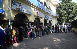 November 13, 2016 - Kolkata, West Bengal, India - To facilitate smooth exchange and deposit the old Rs. 500 and Rs. 1000 bank note bank across India remain open for public on Sunday , as announced by Union Government after demonetized Rs.500 and Rs.1000 bank notes to tackle the menace of black money. Indian line up outside the banks to deposit and exchange demonetized bank note from late night. (Credit Image: © Saikat Paul/Pacific Press via ZUMA Wire)