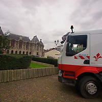 A municipal truck helps set up for a festival to help cheer up a gloomy day in front of the Palais des Beaux-Arts of Lille, one of France's preimer art museums.