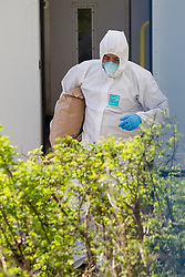 © Licensed to London News Pictures . 30/04/2013 . Salford , Greater Manchester , UK . A forensic scenes of crime examiner removes a holdall in a forensic bag from the prison van . Police and forensic scenes of crime examiners at the scene on Regent Road , Salford , where a prison van was hijacked this morning (Tuesday 30th April) . Police report that two prisoners escaped . Photo credit : Joel Goodman/LNP