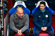 Manchester City Manager Pep Guardiola and Manchester City Assistant coach Mikel Arteta before the Premier League match between Crystal Palace and Manchester City at Selhurst Park, London, England on 14 April 2019.