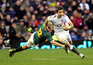 © SPORTZPICS /Seconds Left Images 2010 - England's Ben Foden skips past the tackle of the diving Jean de Villiers England v South Africa  - Investec Challenge Series - 27/11/20110 - Twickenham Stadium  - London - All rights reserved.