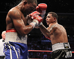 Aug 21, 2010; Newark, NJ, USA; Joel Julio and Jamaal Davis trade punches during their 10 round junior middleweight bout at the Prudential Center.