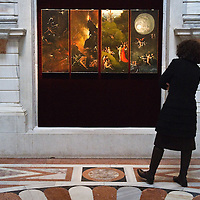 "VENICE, ITALY - JANUARY 10: A memebr of staff admires ""Paradise and Hell"" panels by Hieronymus Bosch on display in the Tribuna room at Palazzo Grimani on January 10, 2011 in Venice, Italy. The  exhibition will be open until 20th March 2011."