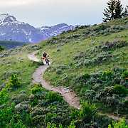Heather Goodrich rides the Singletrack trails of Jackson, Wyoming at sunset.