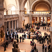 Crowds of visitors at the main entrance hall of the Metropolitan Museum of Art in New York, New York.