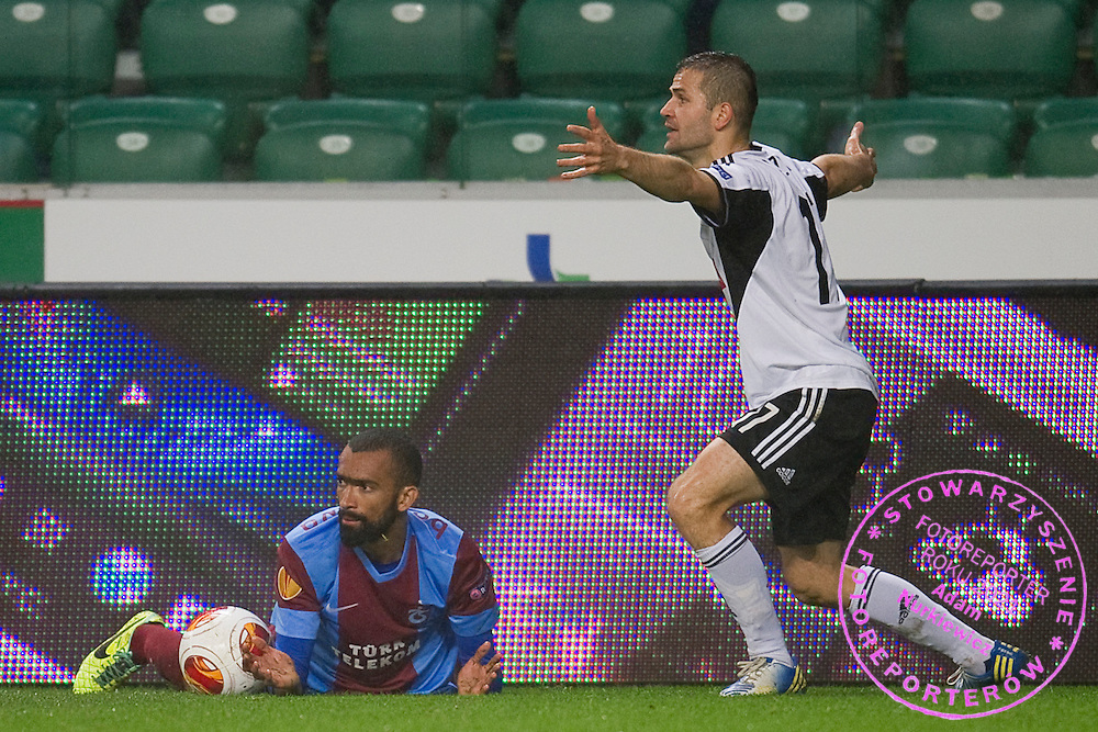(R) Legia's Tomasz Brzyski and (L) Trabzonspor's Jose Bosigwa react after foul  during the UEFA Europa League Group J football match between Legia Warsaw and Trabzonspor AS at Pepsi Arena Stadium in Warsaw on November 07, 2013.<br /> <br /> Poland, Warsaw, November 07, 2013<br /> <br /> Picture also available in RAW (NEF) or TIFF format on special request.<br /> <br /> For editorial use only. Any commercial or promotional use requires permission.<br /> <br /> Mandatory credit:<br /> Photo by &copy; Adam Nurkiewicz / Mediasport