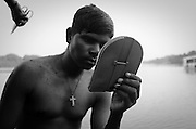 Roshan is from Jharkand. He goes to Goa as soon as the fishing season starts after the monsoons. When I photographed him in May 2015, he was living in a boat by the backwaters of Britona, North Goa. His friend was giving him a haircut.
