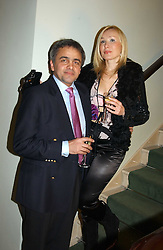 MR BALDASSARE LA RIZZA and VALENTINA DROUIN at the opening party of Pengelley's, 164 Sloane Street, London SW1 on 22nd February 2005.<br />