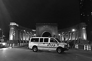 Dec. 4, 2014 - Manhattan, NY. An NYPD van parked on the sidewalk in front of the manhattan bridge during the Eric Garner protests. 12/4/14 Photograph by Daniel Cassady/NYCity Photo Wire