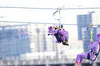 Minneapolis, MN - January 26, 2017: Bold North Zip Line riders wearing a purple unicorn costumes, zoom down the line and over the Mississippi River as part of the SuperBowl LII events taking place in Minneapolis.
