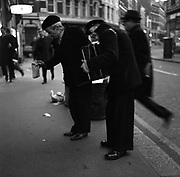 Blind Beggars outside Farringdon Underground Station in 1970. London England<br /> This was quite a common scene in England at the time. Many of the men playing instruments to earn some small change were veterans from the Second World War.