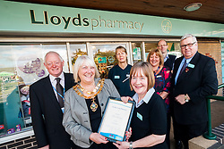 Lloyds Pharmacy Stocksbridge has achieved the status of 'Healthy Living Pharmacy'. A special accreditation for offering high levels of health screening  and advice to the local community. Pharmacy Manager Jackie Walter receiving the award from Mayor of Stocksbridge Susie Abrahams, also pictured left to right are NHS Sheffield Commissioning Manager Gareth Johnstone, Lloyds Stcksbridge Healthy Living Champion Vikki Sheppard, Valley Medical Centre Practace Manager Liz Sedgwick Dr Peter Moulsher GP and Lloyds Area Manager Greg Campbell....04 October 2012.Image © Paul David Drabble