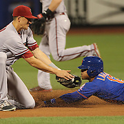 Short stop Nick Ahmed, Arizona Diamondbacks, doesn't tag in time as Juan Lagares, New York Mets, steals second base during the New York Mets Vs Arizona Diamondbacks MLB regular season baseball game at Citi Field, Queens, New York. USA. 10Th July 2015. Photo Tim Clayton