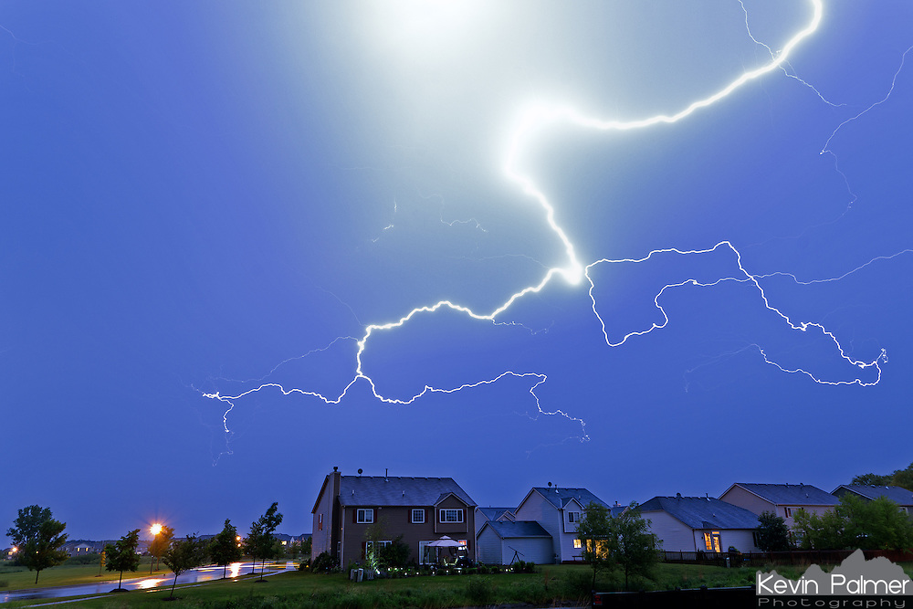 A powerful bolt of lightning appears to hover over a row of houses. This midsummer thunderstorm lasted 6+ hours and produced lots of similar lightning bolts.<br /> <br /> Date Taken: June 8, 2011