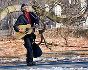 This one was taken in late Winter. This man was enjoying himself, playing and singing, to no one in particular. The park was almost empty.