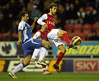 Photo: Paul Thomas.<br /> Wigan Athletic v Arsenal. The Barclays Premiership. 13/12/2006.<br /> <br /> Josip Skoko (L) of Wigan is beaten to the ball by Mathieu Flamini.