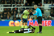 Steve Cook (#3) of AFC Bournemouth checks on the injured Jetro Willems (#15) of Newcastle United during the Premier League match between Newcastle United and Bournemouth at St. James's Park, Newcastle, England on 9 November 2019.