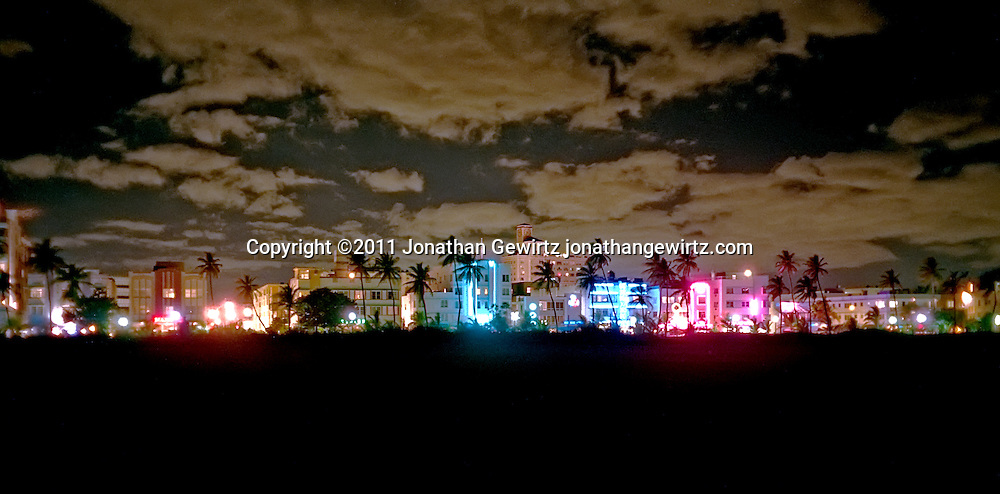 The South Beach hotel and entertainment district at night in December 1995. This view from the beach is now blocked by palm trees and restored sand dunes. WATERMARKS WILL NOT APPEAR ON PRINTS OR LICENSED IMAGES.