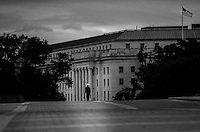 WASHINGTON, DC - SEPTEMBER 27:  Government worker walks to his office along the Capitol Plaza on the east front of the US Capitol, on Capitol Hill Friday September 27, 2013. (Photo by Melina Mara/The Washington Post)