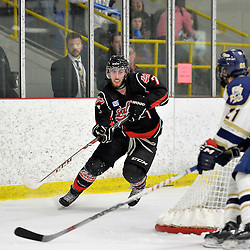 """FORT FRANCES, ON - May 1, 2015 : Central Canadian Junior """"A"""" Championship, game action between the Fort Frances Lakers and the Toronto Patriots, semi-final game of the Dudley Hewitt Cup. Nick Minerva #7 of the Fort Frances Lakers clears the puck from behind his net during the third period.<br /> (Photo by Shawn Muir / OJHL Images)"""