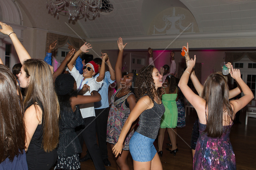 teenagers enjoying themselves at a Bat Mitzvah party by dancing