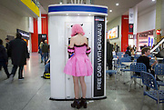 UNITED KINGDOM, London: 23 October 2015 A cosplay fan gets money from a cash machine at the 2015 MCM London Comic Con which is being held at London's ExCel Arena. The event will be host to more than 110,000 comic con fans and cosplay enthusiasts over the weekend. Rick Findler / Story Picture Agency