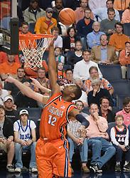Virginia forward Jamil Tucker (12) leaps for a rebound against Duke.  The Virginia Cavaliers men's basketball team faced the Duke Blue Devils at the University of Virginia's John Paul Jones Arena in Charlottesville, VA on March 5, 2008.