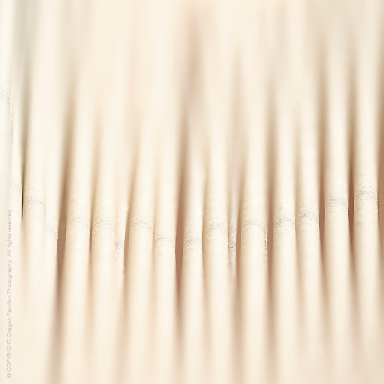 macro image of strands of dry spaghetti cropped to square format