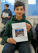 Merrick, New York, U.S.  December 20, 2019.  DEVEN KIRPALANI, 14, of Merrick, holds his winning ticket, with picture of baby Yoda and 'Winner You Are! Feel the Force' on it, at book signing for author Kevin Shinick's STAR WARS: FORCE COLLECTOR at North Merrick Library on Nassau County Force Collector Day. Kirpalani is a student at Calhoun High School, where the author graduated from. All children who didn't have the novel at event picked winning tickets for Shinick's new official canon Star Wars young adult novel. Shinick named home planet of Karr Nuq Sin, the main character, MEROKIA in honor of Merokee tribe who settled his Merrick hometown on Long Island.