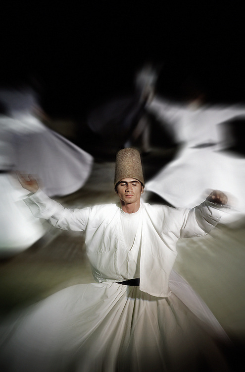 """A dervish performs the Sema Ceremony, in front of the Mevlana Mausoleum, in the city of Konya, Turkey. Sufism is a mystical tradition of Islam. Also considered as a spiritual and ascetic movement of Islam with esoteric doctrines appeared during the VIII century. The Muslim Sufis are people who privilege internalization, the love of god, contemplation and wisdom. A practitioner of this tradition is generally known as a Sufi, another name used for the Sufi seeker is """"dervish"""". The Sufi movement has spanned several continents and cultures over a millennium, at first expressed through Arabic, then through Persian, Turkish, and a dozen other languages. Sufi orders, most of which are Sunni in doctrine, trace their origins from the Prophet of Islam, Muhammad, through his cousin Ali or his father-in-law Abu Bakr. According to some modern proponents, the Sufi philosophy is universal in nature and its roots predate the arising of the modern-day religions. The whirling dance or Sufi whirling that is associated with dervishes, is the practice of the Mevlevi Order in Turkey, and is just one of the physical methods used to try and reach religious ecstasy. Condemned by traditional Islam, the Sufism cultivates the mystery; the idea being that Muhammad would have received at the same time the Koran and esoteric revelations."""