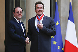 April 28, 2017 - Paris, France - French President FRANCOIS HOLLANDE shakes hands with US actor and former governor of California ARNOLD SCHWARZENEGGER after he was awarded France's highest order the Chevalier (Knighthood) de la Legion d'Honneur at the Elysee palace. (Credit Image: © Geoffroy Van Der Hasselt/NurPhoto via ZUMA Press)