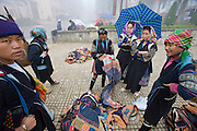 Black Hmong hilltribe women selling clothes and souvenors to tourists.