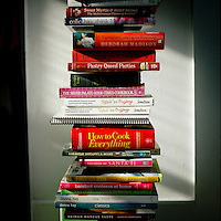 A collection of cookbooks at home.