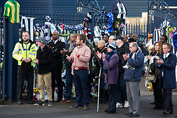 © Licensed to London News Pictures. 30/01/2018. The funeral of footballer Cyrille Regis took place in West Bromwich today. The hearse made it's way past the football ground where he played as family, friends and fans said their final farewell. Pictured, fans applaud the hearse. Photo credit: Dave Warren/LNP