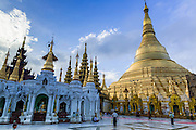 15 JUNE 2013 - YANGON, MYANMAR:  Shwedagon Pagoda is officially known as Shwedagon Zedi Daw and is also called the Great Dagon Pagoda or the Golden Pagoda. It is a 99 metres (325 ft) tall pagoda and stupa located in Yangon, Burma. The pagoda lies to the west of on Singuttara Hill, and dominates the skyline of the city. It is the most sacred Buddhist pagoda in Myanmar and contains relics of the past four Buddhas enshrined: the staff of Kakusandha, the water filter of Ko??gamana, a piece of the robe of Kassapa and eight strands of hair fromGautama, the historical Buddha. The pagoda was built between the 6th and 10th centuries by the Mon people, who used to dominate the area around what is now Yangon (Rangoon). The pagoda has been renovated numerous times through the centuries. Millions of Burmese and tens of thousands of tourists visit the pagoda every year, which is the most visited site in Yangon.  PHOTO BY JACK KURTZ
