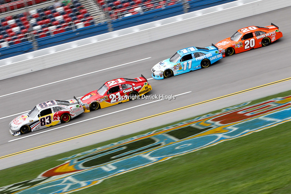 April 15, 2011; Talladega, AL, USA; NASCAR Sprint Cup Series drivers Brian Vickers (83), Trevor Bayne (21), Denny Hamlin (11) and Joey Logano (20) during practice for the Aarons 499 at Talladega Superspeedway.   Mandatory Credit: Derick E. Hingle