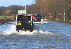 Vehicles make their way along the flooded Windsor Road in Egham, United Kingdom. Saturday, 8th February 2014. Picture by Max Nash / i-Images