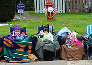 12/1/12 12:16:56 PM - Souderton, PA: .Isabella Scahffer (L), Allison Scahffer, both 8, and Madison Scahffer 3, all of Lansdale, Pennsylvania are bundled up as they watch the procession on Main Street during the Souderton/Telford Holiday Parade December 1, 2012 in Souderton, Pennsylvania -- (Photo by William Thomas Cain/Cain Images)