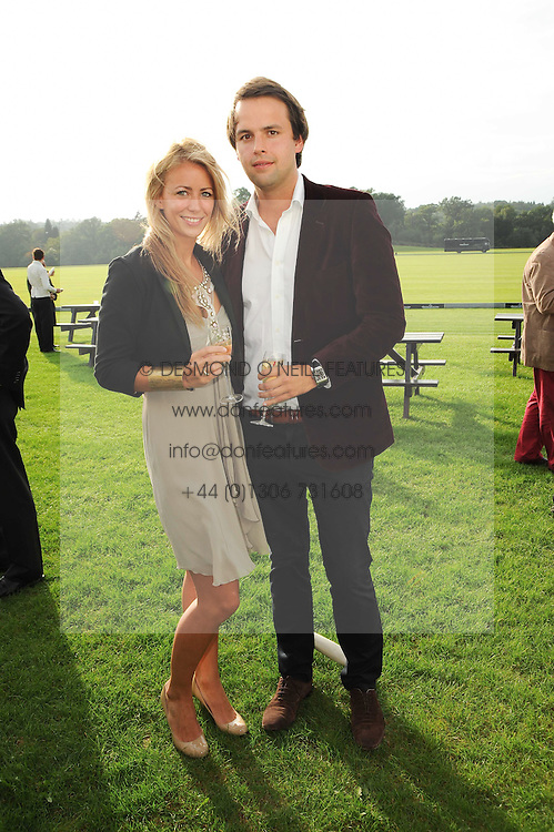 CHARLIE GILKES and ANNEKE VON TROTHA TAYLOR at the 4th Jaeger-LeCoultre Polo Cup in aid of the James Wentworth-Stanly Memorial Fund held at Coworth Park, Ascot, Berkshire on 10th September 2010.