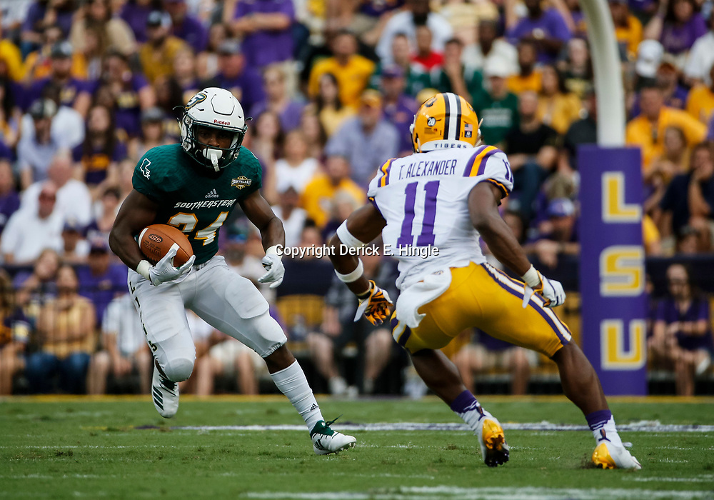 Sep 8, 2018; Baton Rouge, LA, USA; Southeastern Louisiana Lions running back Darren Johnson (24) is pursued by LSU Tigers cornerback Terrence Alexander (11) during the first quarter of a game at Tiger Stadium. Mandatory Credit: Derick E. Hingle-USA TODAY Sports