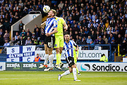 Sheffield Wednesday defender Tom Lees (15) heads away ahead of Brighton striker, Tomer Hemed (10)   during the Sky Bet Championship play-off first leg match between Sheffield Wednesday and Brighton and Hove Albion at Hillsborough, Sheffield, England on 13 May 2016. Photo by Simon Davies.
