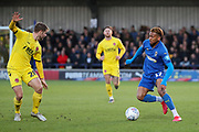 AFC Wimbledon attacker Julien Lamy (17) taking on Fleetwood Town midfielder Jack Sowerby (28) during the EFL Sky Bet League 1 match between AFC Wimbledon and Fleetwood Town at the Cherry Red Records Stadium, Kingston, England on 8 February 2020.